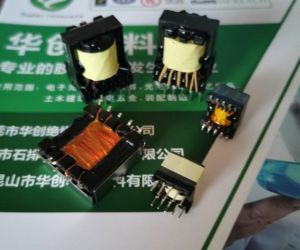 PBT材质的变压器骨架用什么胶水可以粘?常规的变压器磁芯黑胶粘得牢吗?